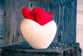 Two red hearts twig board white cup — Стоковое фото