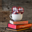 Three Hearts board white mug books — Stock Photo