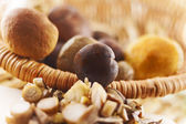 Wooden basket full fresh mushrooms — Stock Photo