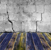 Grunge stone wall painted wooden floor — Stock Photo