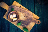 Cutting boards spices old wooden table — Stock Photo