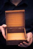 Empty casket hands man — Stockfoto