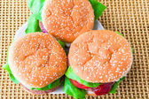 Closeup three fresh burgers — Stock Photo