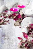 Stones candles petals rose wooden background — Stock Photo