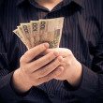 Man holds hands Polish money — Stock Photo