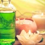 Oil massage aromatic candles stones Zen — Stock Photo #42804353