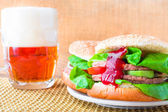 Homemade grilled hamburger cold beer — Stock Photo