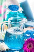 Preparing relaxing spa bath aromatic pouring salt — Stock Photo
