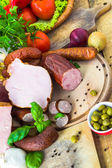 Variety processed meat products vegetables — Stok fotoğraf