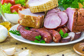 Composition variety meats sausages — Stock Photo