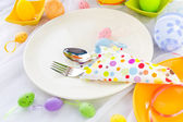 Easter table setting silverware wrapped napkin — Stock Photo