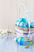 Basket Easter eggs spring branches — Stock Photo