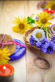 Handmade soap flowers wooden table — Stockfoto