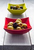 Colorful fruits olives bowls wooden table — Stockfoto