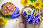 Handmade soap flowers wooden table — Stock Photo