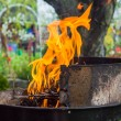 Lighting fire during spring barbecue garden — Stock Photo #45851729