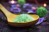 Spa concept closeup green bathing salt — Stock Photo