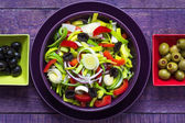 Fresh colorful vegetable salad platter wooden table — Stock Photo