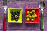 Colorful fruits olives bowls wooden table — Stock Photo