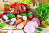 Variety processed meat products vegetables — Stock Photo