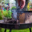Lighting fire during spring barbecue garden — Stock Photo #46401073