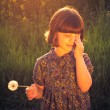 Pretty little girl dandelions field rape — Stock Photo #47684047