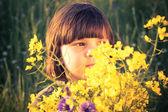 Beauty little girl rape field bouquet hand — Stock Photo