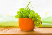 Fruit grapes cup wooden teble — Stock Photo