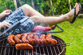 Garden party roasted sausages grill — Stock Photo