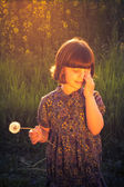 Pretty little girl dandelions field rape — Zdjęcie stockowe
