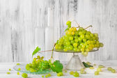 Still life fruit bottlle wine grapes — Stock Photo