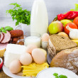 Miscellaneous food dairy products bread meat — Stock Photo
