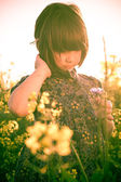Little girl rape field bouquet hand — Stock Photo