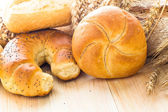 Various bakery products wooden background — Stock Photo