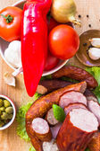 Various meats vegetables wooden table — Stock Photo