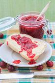 Wheat bread butter jam gooseberry — Stock Photo
