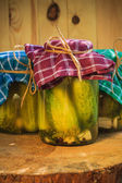 Jars pickled gherkins wooden table — Stock Photo