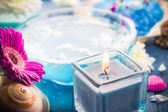 Elements spa relaxation including candles water salt bath — Stock Photo