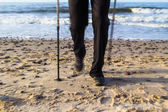 Nordic walking sport run walk motion blur outdoor person legs se — Stock Photo