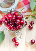 Summer fruits closeup cherries jar processed — Stock Photo