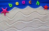 The word beach laid sand — Stockfoto