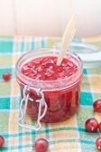 Gooseberry jam spoon jar — Stock Photo