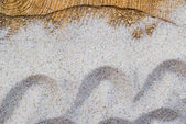 Marine background sand spilled wooden table — Stock Photo