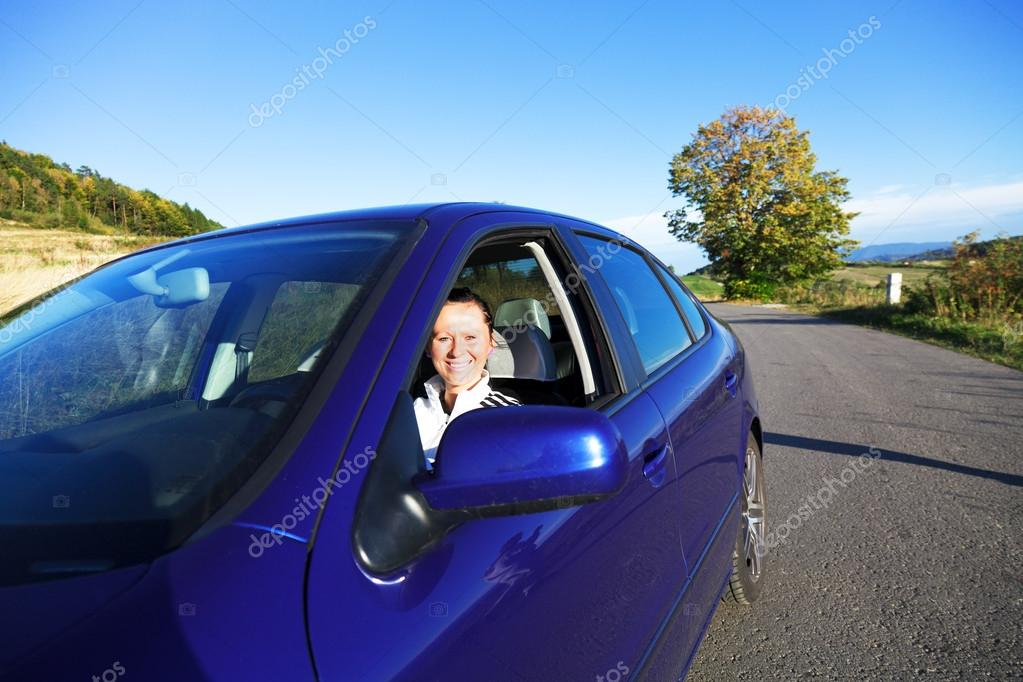 Young Pretty Girl riding in a car   Stock Photo #13223612