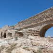 Ancient Roman aqueduct in Ceasarea - Stock Photo