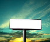 Empty billboard on background of sunset sky — Stock Photo