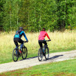 Two cyclists relax biking — Stock Photo #32307027