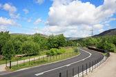 Strada curva sulla montagna — Foto Stock