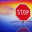 Stop sign at water - Stock Photo