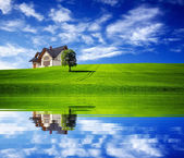 New house on green field — Stock Photo